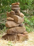 rocks used for an offering altar, stacked as garden art